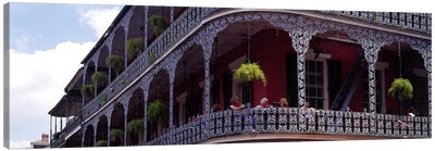 People sitting in a balcony, French Quarter, New Orleans, Louisiana, USA Canvas Art Print