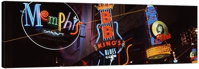 Low angle view of neon signs lit up at night, Beale Street, Memphis, Tennessee, USA Canvas Art Print