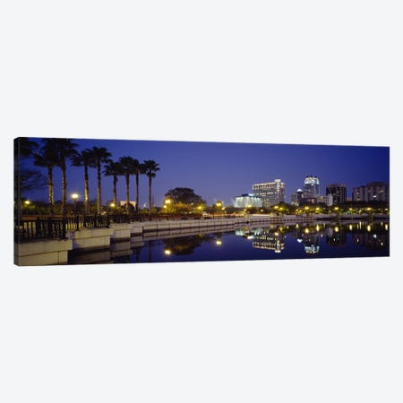 Reflection of buildings in water, Orlando, Florida, USA Canvas Print #PIM3062} by Panoramic Images Canvas Wall Art