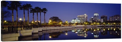 Reflection of buildings in water, Orlando, Florida, USA Canvas Art Print