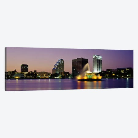 Fountain in a lake lit up at night, Lake Eola, Summerlin Park, Orlando, Orange County, Florida, USA Canvas Print #PIM3064} by Panoramic Images Art Print