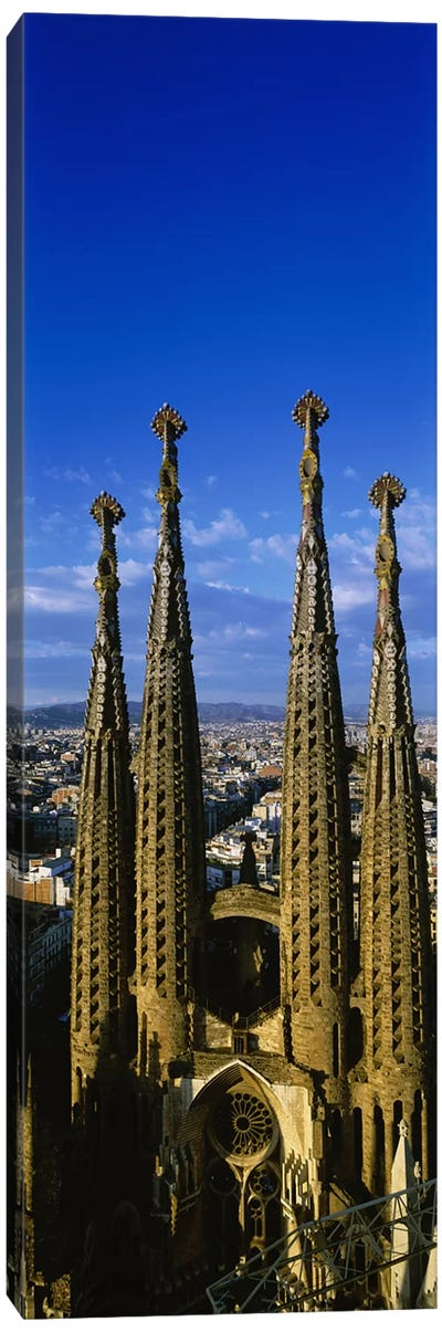 High Section View Of Towers Of A Basilica, Sagrada Familia, Barcelona, Catalonia, Spain Canvas Print #PIM3076