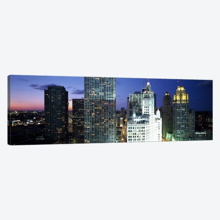 Skyscraper lit up at night in a city, Chicago, Illinois, USA Canvas Print #PIM3079} by Panoramic Images Canvas Art Print