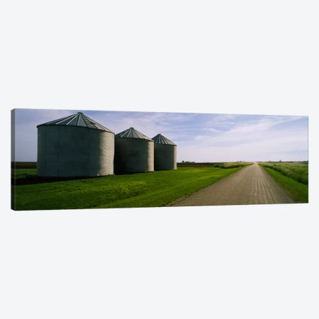 Three silos in a field Canvas Print #PIM308} by Panoramic Images Art Print