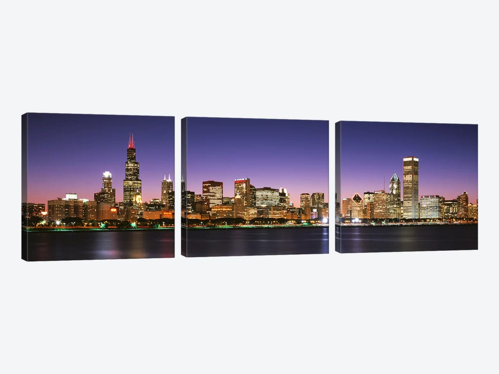 Skyscrapers lit up at night at the waterfront, Lake Michigan, Chicago, Cook County, Illinois, USA by Panoramic Images 3-piece Canvas Art
