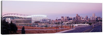 USA, Colorado, Denver, Invesco Stadium, Skyline at dusk Canvas Art Print