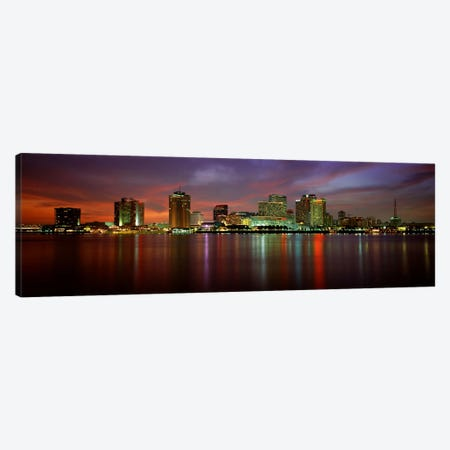 Buildings lit up at the waterfront, New Orleans, Louisiana, USA Canvas Print #PIM3334} by Panoramic Images Canvas Print
