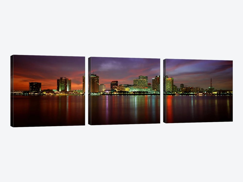 Buildings lit up at the waterfront, New Orleans, Louisiana, USA by Panoramic Images 3-piece Canvas Print