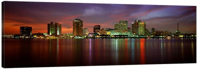 Buildings lit up at the waterfront, New Orleans, Louisiana, USA Canvas Art Print