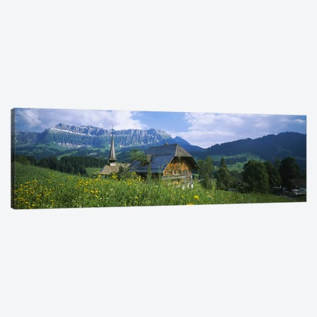 Chalet and a church on a landscape, Emmental, Switzerland Canvas Print #PIM3344} by Panoramic Images Canvas Artwork