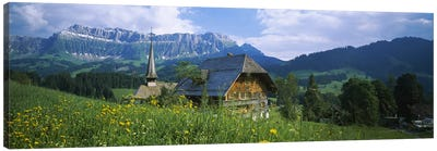 Chalet and a church on a landscape, Emmental, Switzerland Canvas Art Print