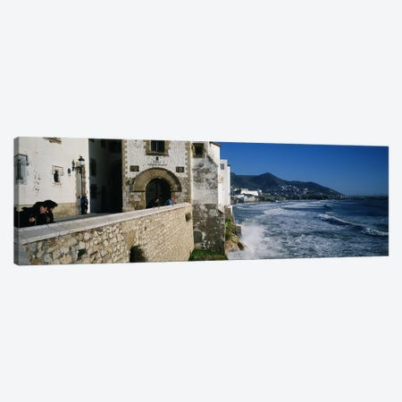 Tourists in a church beside the sea, Sitges, Spain Canvas Print #PIM3382} by Panoramic Images Art Print