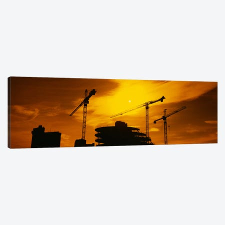 Cranes In An Orange Dusk, London, England, United Kingdom Canvas Print #PIM3429} by Panoramic Images Canvas Artwork