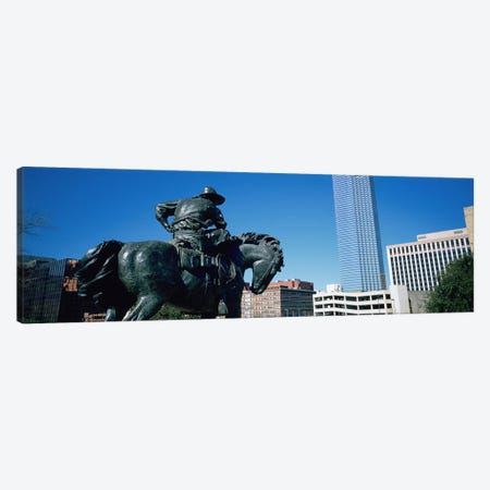 Low Angle View Of A Statue In Front Of Buildings, Dallas, Texas, USA Canvas Print #PIM3473} by Panoramic Images Art Print