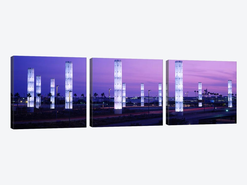 Light sculptures lit up at night, LAX Airport, Los Angeles, California, USA by Panoramic Images 3-piece Canvas Print
