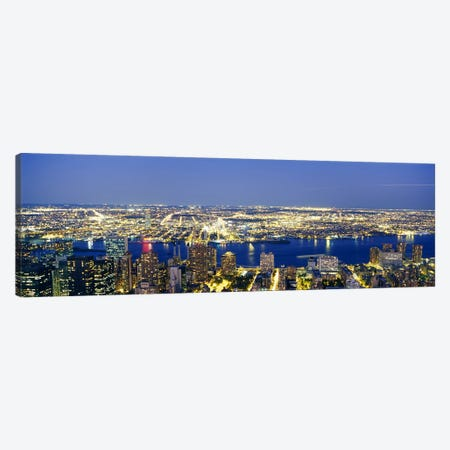 Aerial View of Buildings Lit Up At DuskManhattan, NYC, New York City, New York State, USA Canvas Print #PIM3601} by Panoramic Images Canvas Artwork