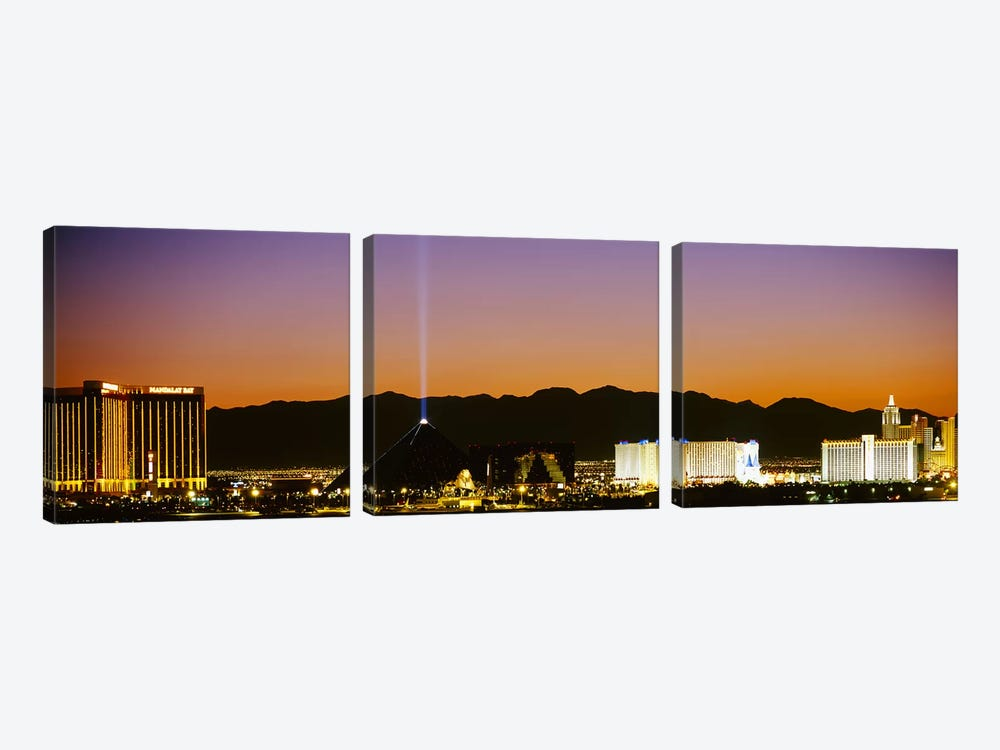 Buildings in a city lit up at night, Las Vegas, Nevada, USA by Panoramic Images 3-piece Canvas Print