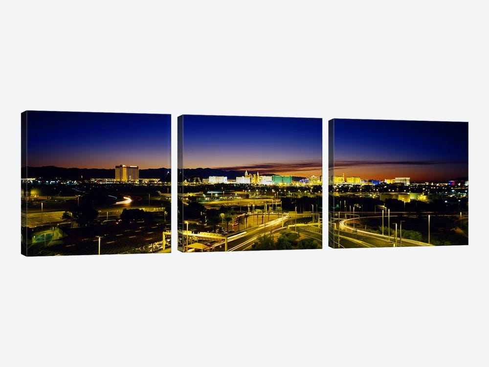 High angle view of buildings lit up at dusk, Las Vegas, Nevada, USA by Panoramic Images 3-piece Canvas Art Print