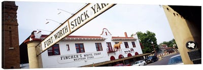Low angle view of a commercial signboardFort Worth Stockyards, Fort Worth, Texas, USA Canvas Print #PIM3655