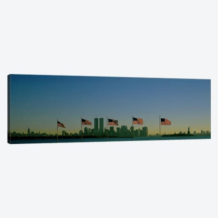View Of Manhattan Through A Row Of American Flags At Flag Plaza, Liberty State Park, New Jersey Canvas Print #PIM3703} by Panoramic Images Canvas Print