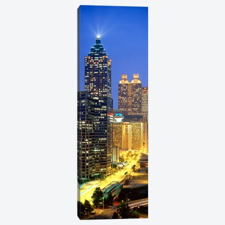 Skyscrapers lit up at night, Atlanta, Georgia, USA Canvas Print #PIM3751} by Panoramic Images Canvas Art