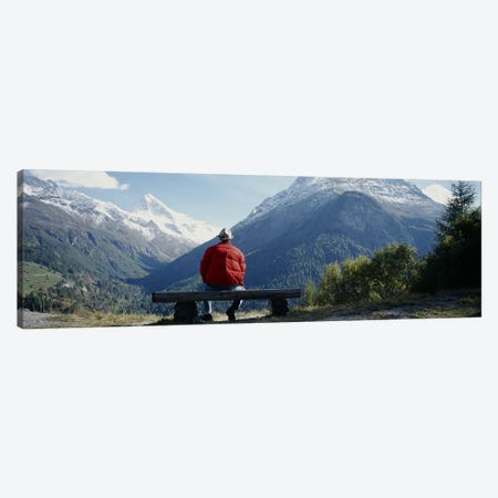 Hiker Contemplating Mountains Switzerland Canvas Print #PIM3802} by Panoramic Images Canvas Wall Art