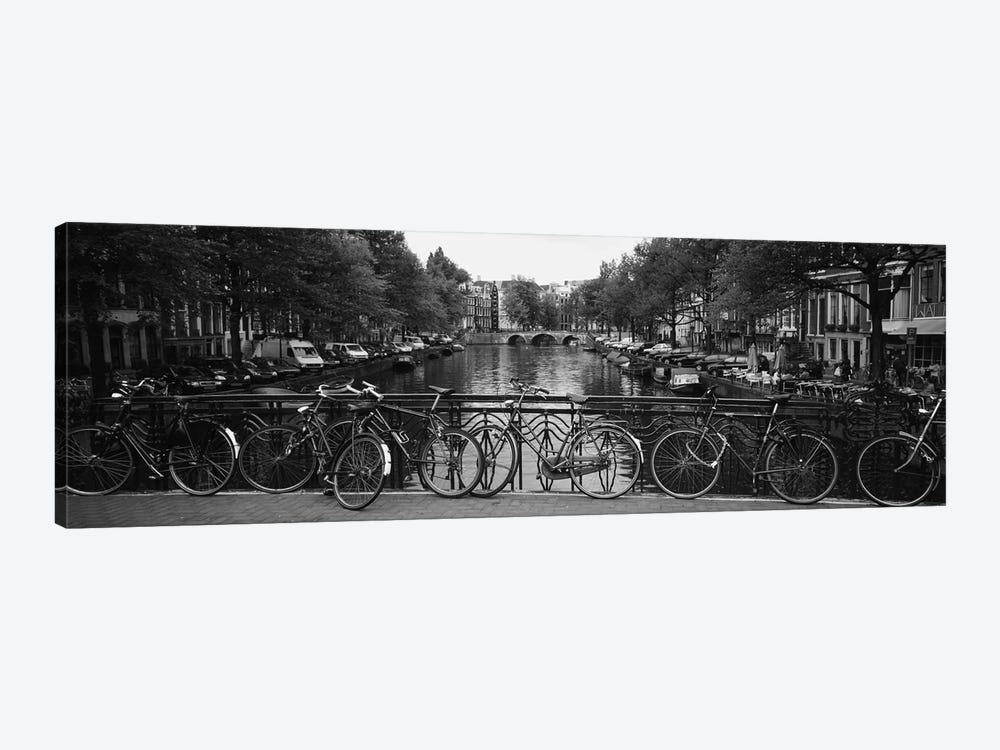 Bicycle Leaning Against A Metal Railing On A Bridge, Amsterdam, Netherlands by Panoramic Images 1-piece Canvas Artwork