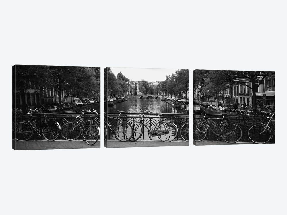 Bicycle Leaning Against A Metal Railing On A Bridge, Amsterdam, Netherlands by Panoramic Images 3-piece Canvas Art