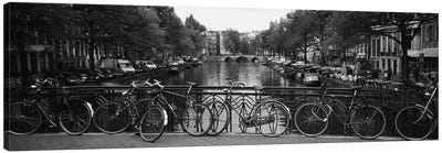 Bicycle Leaning Against A Metal Railing On A Bridge, Amsterdam, Netherlands Canvas Art Print