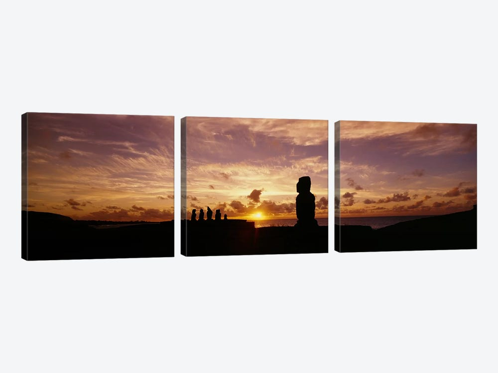 Silhouette of Moai statues at dusk, Tahai Archaeological Site, Rano Raraku, Easter Island, Chile by Panoramic Images 3-piece Canvas Print