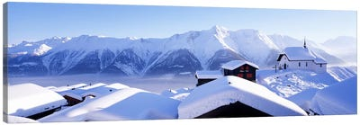 Snow Covered Chapel and Chalets Swiss Alps Switzerland Canvas Print #PIM3872