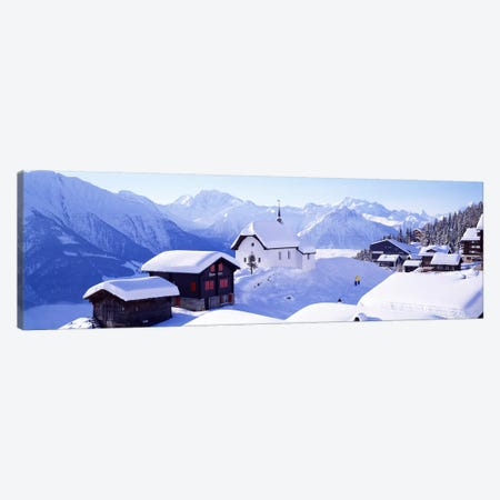 Snow Covered Chapel and Chalets Swiss Alps Switzerland Canvas Print #PIM3873} by Panoramic Images Canvas Print