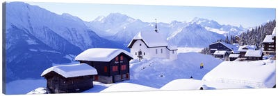 Snow Covered Chapel and Chalets Swiss Alps Switzerland Canvas Print #PIM3873
