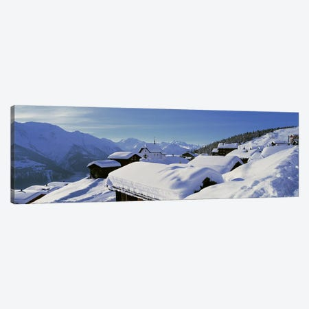 Snow Covered Chapel and Chalets Swiss Alps Switzerland Canvas Print #PIM3874} by Panoramic Images Canvas Wall Art