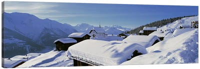 Snow Covered Chapel and Chalets Swiss Alps Switzerland Canvas Print #PIM3874