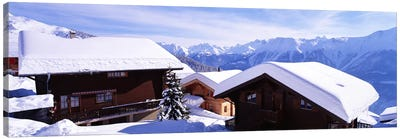 Snow Covered Chapel and Chalets Swiss Alps Switzerland Canvas Print #PIM3875