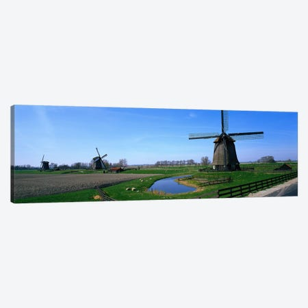 Windmills near Alkmaar Holland (Netherlands) Canvas Print #PIM3904} by Panoramic Images Canvas Artwork