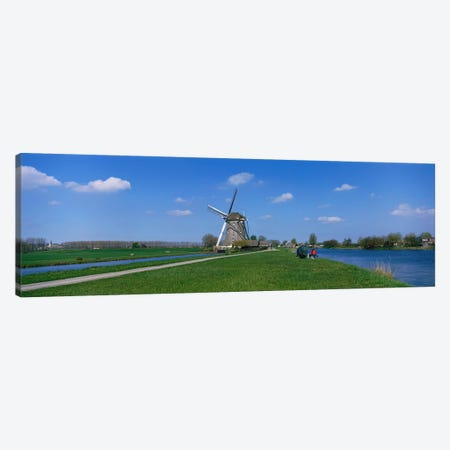 Windmill and Canals near Leiden The Netherlands Canvas Print #PIM3907} by Panoramic Images Canvas Artwork