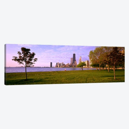 Trees in a park with lake and buildings in the background, Lincoln Park, Lake Michigan, Chicago, Illinois, USA Canvas Print #PIM4075} by Panoramic Images Art Print