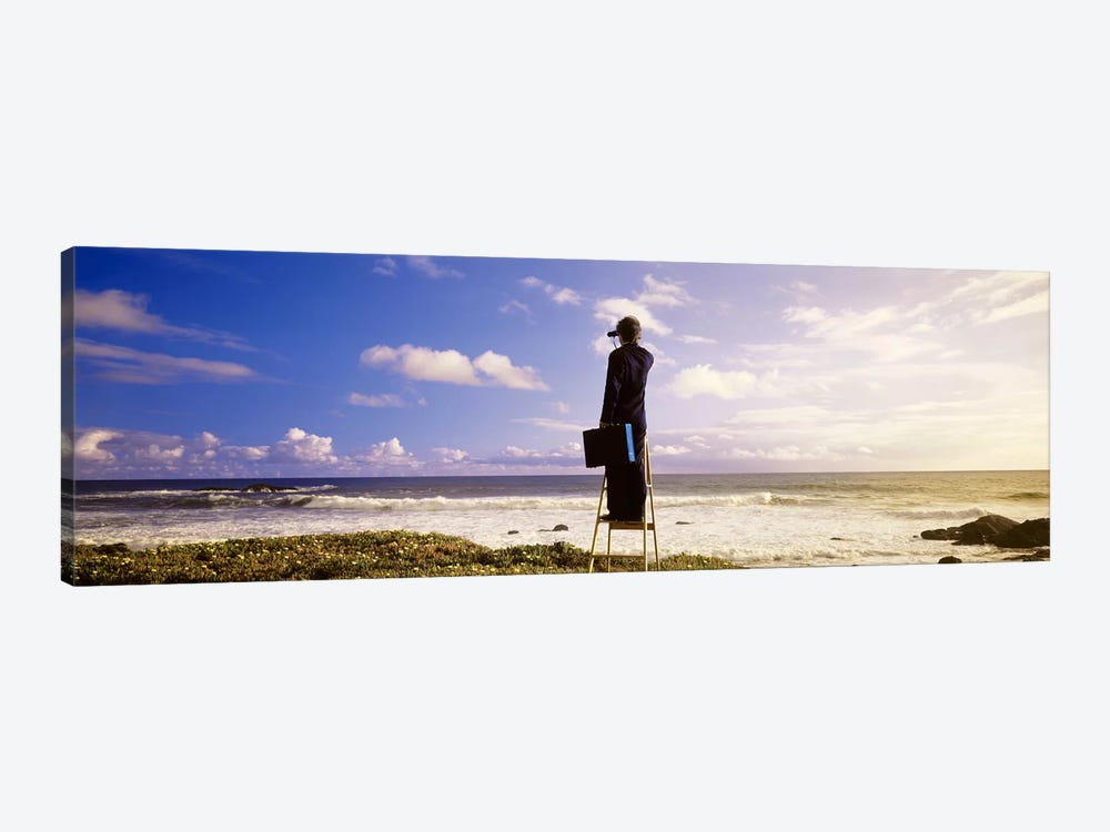 Businessman On A Ladder Looking Through Binoculars On A Beach, California, USA by Panoramic Images 1-piece Canvas Art Print
