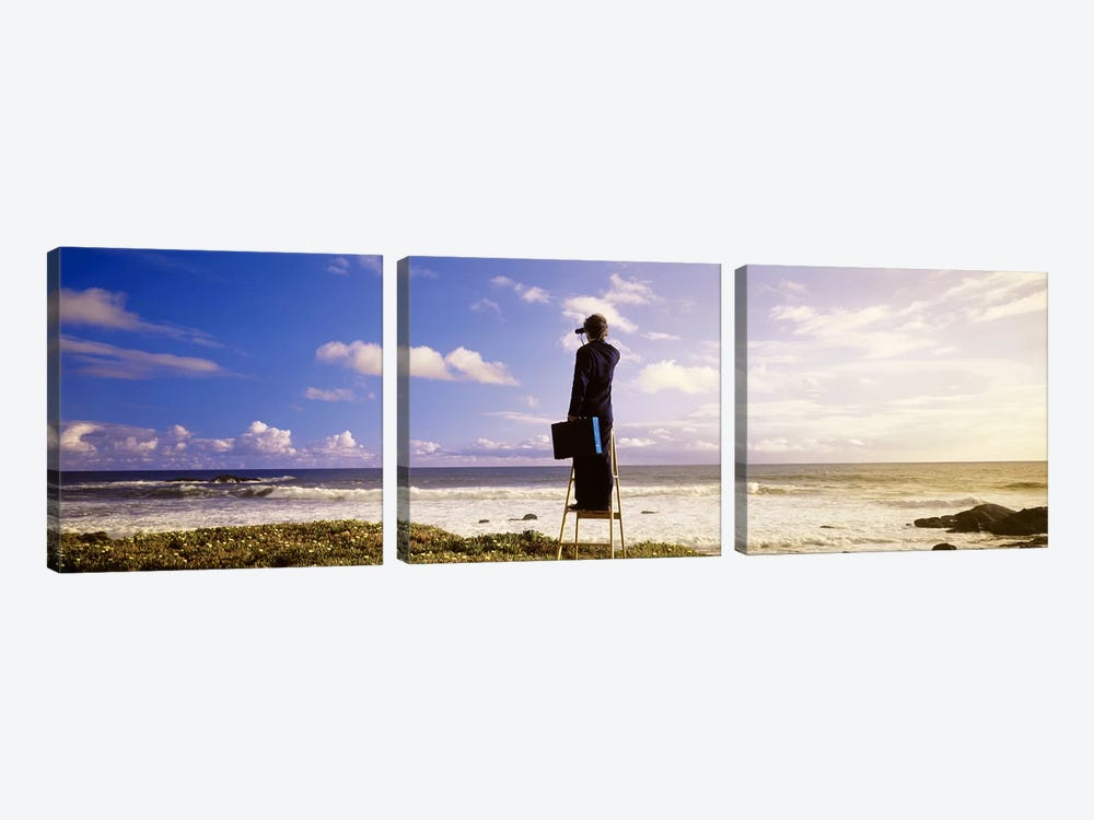 Businessman On A Ladder Looking Through Binoculars On A Beach, California, USA by Panoramic Images 3-piece Canvas Print