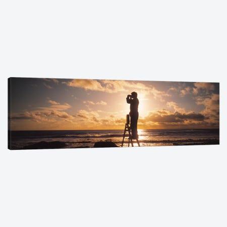 Man Looking Through Binoculars In Silhouette Canvas Print #PIM4145} by Panoramic Images Art Print