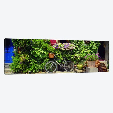 Bicycle Against A Wall Covered With Plants And Flowers, Rochefort-en-Terre, Brittany, France Canvas Print #PIM4204} by Panoramic Images Canvas Art