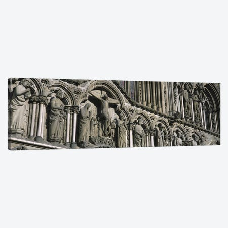 Low angle view of statues carved on wall of a cathedralTrondheim, Norway Canvas Print #PIM4224} by Panoramic Images Canvas Artwork