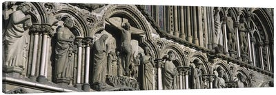Low angle view of statues carved on wall of a cathedralTrondheim, Norway Canvas Print #PIM4224