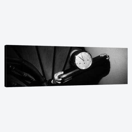 Man Carrying Clock Up Stairs on Shoulders Canvas Print #PIM4245} by Panoramic Images Canvas Wall Art
