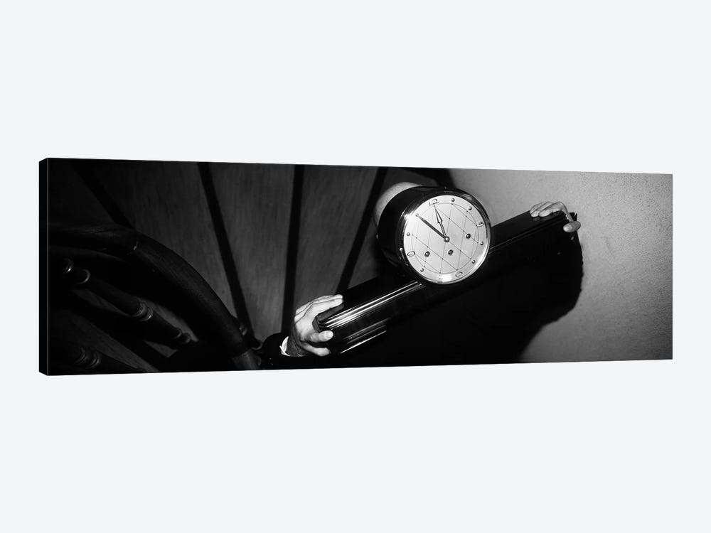 Man Carrying Clock Up Stairs on Shoulders by Panoramic Images 1-piece Canvas Wall Art