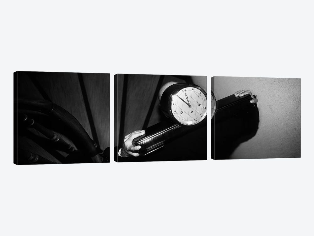 Man Carrying Clock Up Stairs on Shoulders by Panoramic Images 3-piece Canvas Art