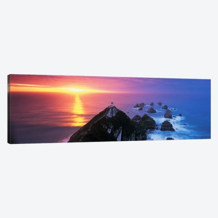 SunsetNugget Point Lighthouse, South Island, New Zealand Canvas Print #PIM4310} by Panoramic Images Canvas Art Print