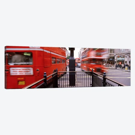 Blurred Motion View Of Double-Decker Buses, Oxford Circus Station Circle, London, England Canvas Print #PIM4337} by Panoramic Images Canvas Wall Art